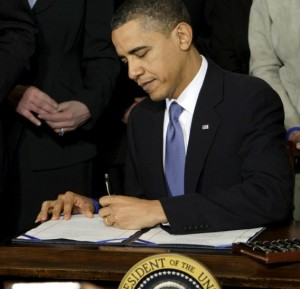 President Obama signs the Affordable Care Act into law on March 23, 2010.
